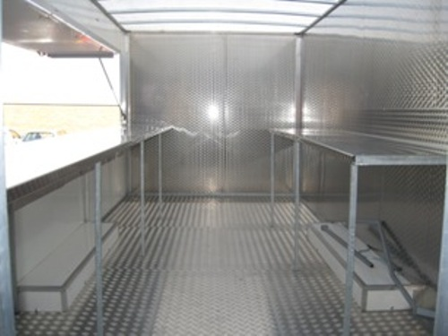 Catering trailer fitted with stainless steel on wall and benches
